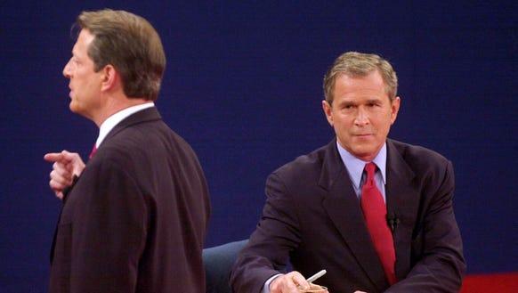 Al Gore and George W. Bush take part in a debate in