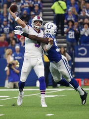 Buffalo Bills quarterback Derek Anderson (3) is hit by Indianapolis Colts defensive end Kemoko Turay (57) as he throws during the first half of an NFL football game in Indianapolis, Sunday, Oct. 21, 2018. (AP Photo/John Minchillo)