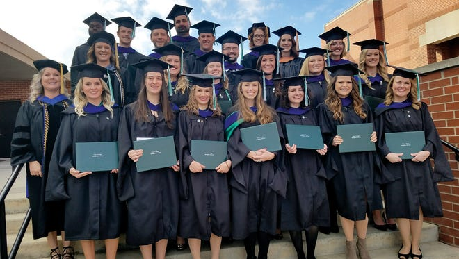 Cox College's first graduating class in its Master's of Occupational Therapy program.
