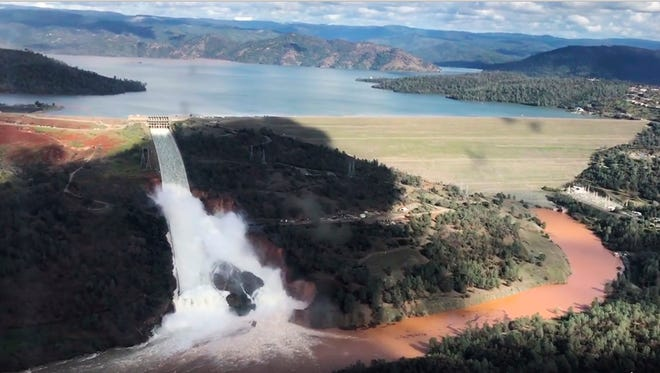 This Friday, Feb. 10, 2017 image from video provided by the office of Assemblyman Brian Dahle shows water flowing over an emergency spillway of the Oroville Dam in Oroville, Calif., during a helicopter tour by the Butte County Sheriff's office. About 150 miles northeast of San Francisco, Lake Oroville is one of California's largest man-made lakes, and the 770-foot-tall Oroville Dam is the nation's tallest.