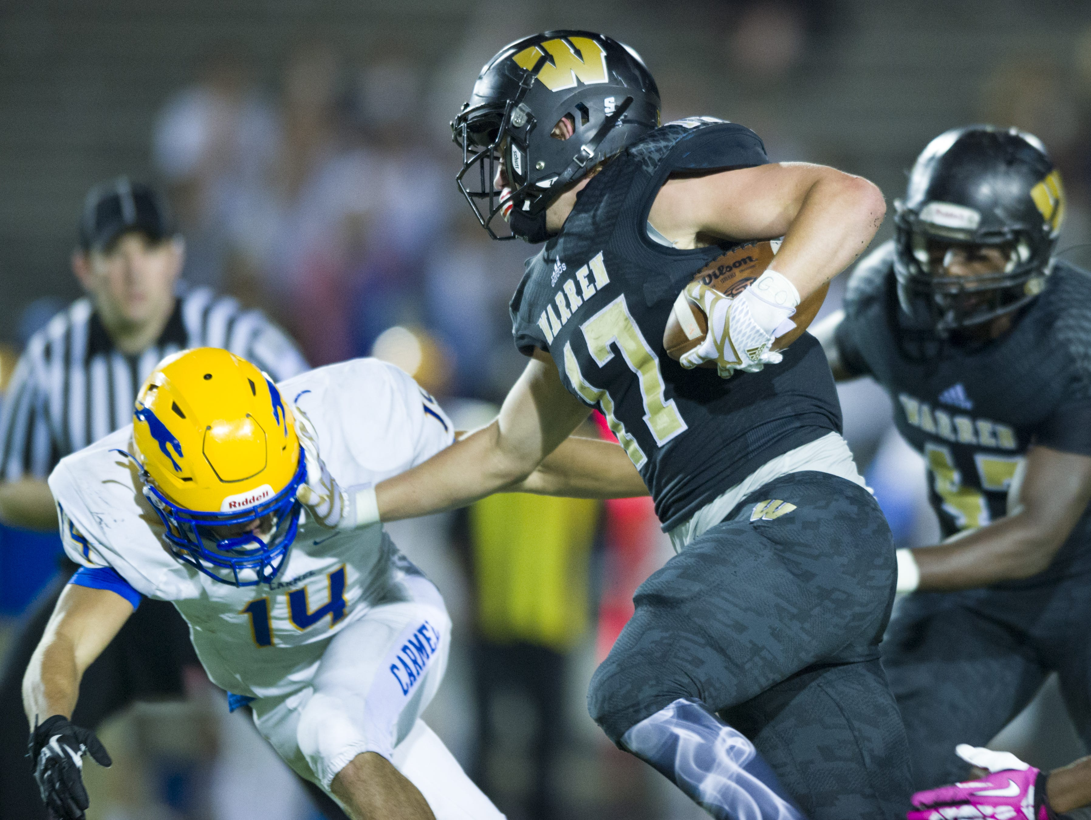 Warren Central senior Tristen Tonte (17) rushes the ball upfield and into the end zone to score during the second half of the game. Warren Central High School hosted Carmel High School in IHSAA varsity football action, Oct. 7, 2016. Warren Central won 40-30.