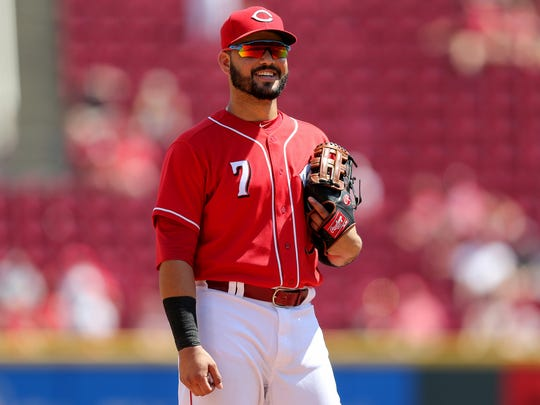Cincinnati Reds third baseman Eugenio Suarez (7) smiles toward the St. Louis Cardinals bench in the eighth inning during a National League baseball between the St. Louis Cardinals and the Cincinnati Reds, Wednesday, July 25, 2018, at Great American Ball Park in Cincinnati.