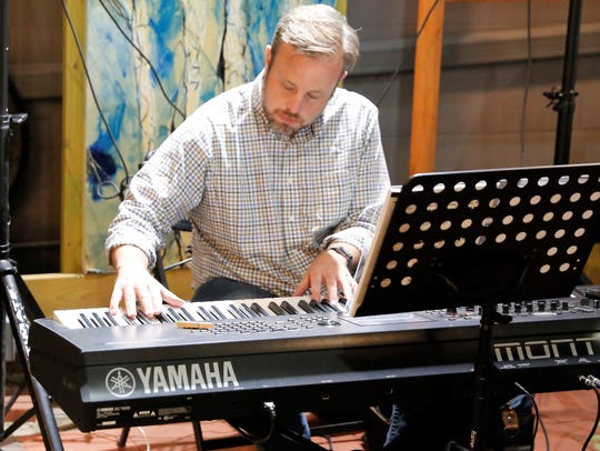 Keyboard player Sheldon Pickering performs during a