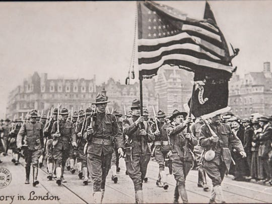 An old copy photo of the troops in WWI is one of the artifacts of an exhibit about the war.
