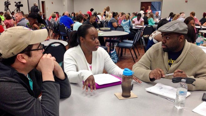 Louisiana College TEACH students Michael Sutton, Lashonda Dempsey and Alex Washington discuss the role of a student advocate during the first breakout session of Thursday's summer training.