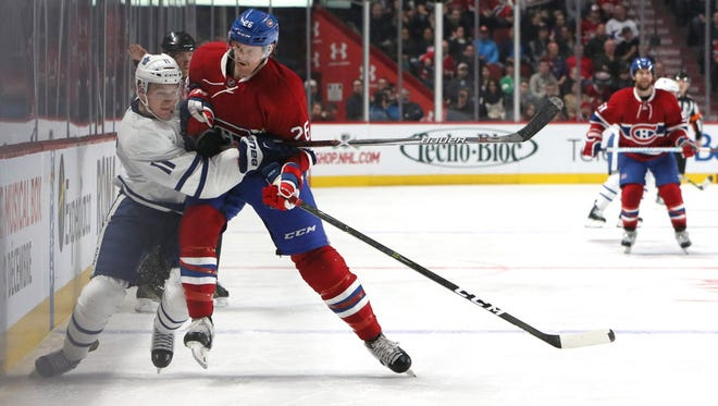 Maple Leafs forward Zach Hyman (11) and Canadiens defenseman Jeff Petry (26) battle for the puck during the third period.