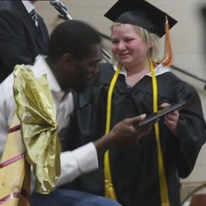 Randy Moss attends MN teen's graduation