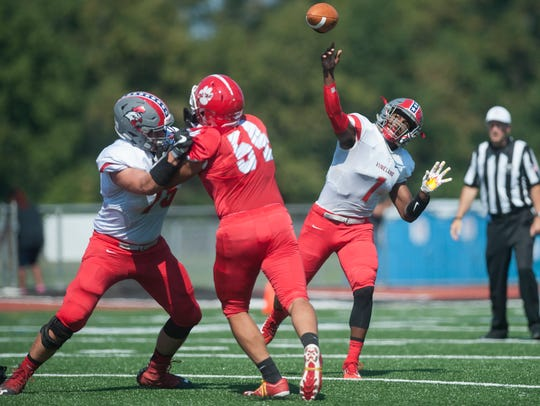 Vineland's Isaih Pacheco releases a pass during the