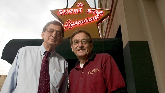 Owners Jimmy, left, and Nicky Koikos pose at the Bright Star Restaurant in Bessemer in October 2005. Jimmy Koikos died of cancer in November 2019.