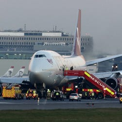 Emergency vehicles surround a Virgin Atlantic Boeing 747 at London's Gatwick Airport on Dec. 29, 2014. The flight was traveling to Las Vegas and returned to the airport because of an issue with its landing gears.