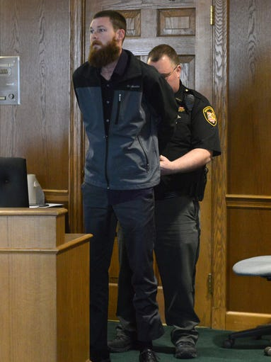Brandon Geiger is handcuffed by Fairfield County Sheriff's