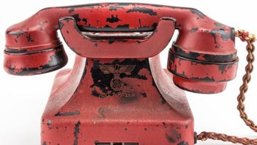 """The Siemens phone, which bears Hitler's name and a swastika is """"arguably the most destructive weapon of all time, which sent millions to their deaths"""" according to a catalog description by Alexander Historical Auctions in Maryland."""