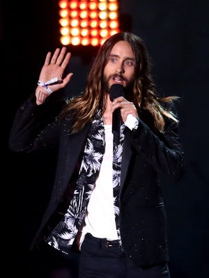 Actor Jared Leto accepts the best onscreen transformation award for 'Dallas Buyers Club' at the 2014 MTV Movie Awards at Nokia Theatre on April 13, 2014 in Los Angeles.