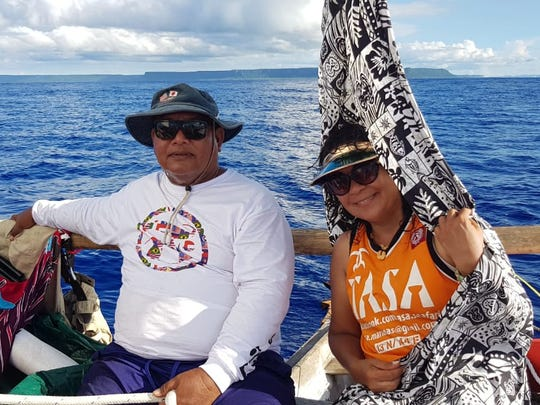 Ali Haleyuri and Sandra Okada sail to Rota and Saipan on an open sea voyage, with Guam's Ritidian Point in the background.