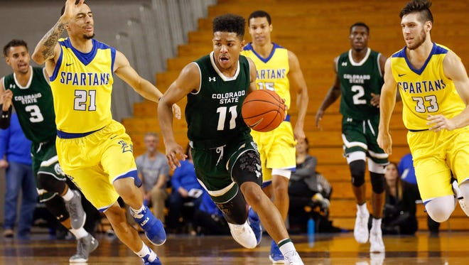 Guard Prentiss Nixon, one of the five CSU players on the floor for the final 7 1/2 minutes of Wednesday night's game, drives past San Jose State defender Jalen James (21). Coach Larry Eustachy said he didn't make any substitutions late in the game to help prepare the Rams for the final 13 games of the regular season and Mountain West tournament with just seven available players.