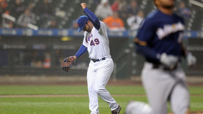 May 30, 2017; New York City, NY, USA; New York Mets relief pitcher Josh Smoker (49) reacts after getting Milwaukee Brewers right fielder Domingo Santana (16) to ground out during the eleventh inning at Citi Field. Mandatory Credit: Brad Penner-USA TODAY Sports