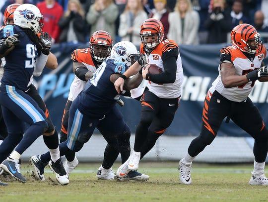 Cincinnati Bengals quarterback Andy Dalton (14) scrambles