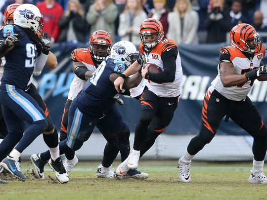 Cincinnati Bengals quarterback Andy Dalton (14) scrambles out of pressure in the fourth quarter during the Week 10 NFL game between the Cincinnati Bengals and the Tennessee Titans, Sunday, Nov. 12, 2017, at Nissan Stadium in Nashville, Tennessee.