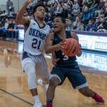 Breaking through: East Lansing boys basketball upends rival Okemos for regional title