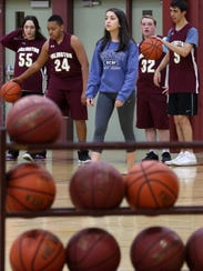 Arlington junior Camille Loussedes works with members