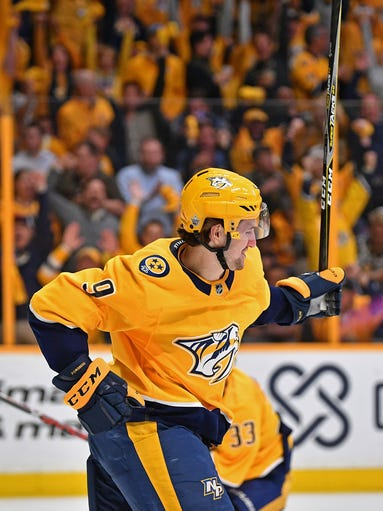 Predators left wing Filip Forsberg (9) pumps his fist
