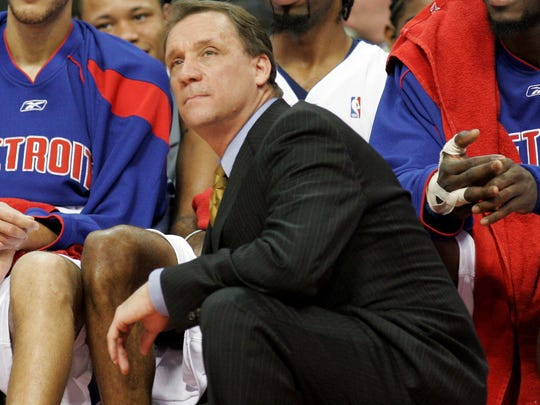 Detroit Pistons coach Flip Saunders and (from left) Tayshaun Prince, Richard Hamilton and Ben Wallace watch the final minutes of Game 2 of their Eastern Conference first-round NBA playoff basketball game against the Milwaukee Bucks in Auburn Hills in 2006. (AP Photo/Duane Burleson, File)