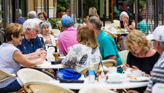 Diners having lunch fill tables outside Bravo Cucina Italiana in Mercato in North Naples on Tuesday, Feb. 21, 2017.