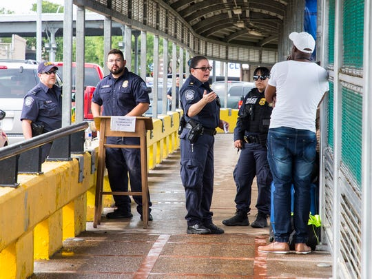 Immigrants seeking asylum in the U.S. are turned away by U.S. Customs and Border Protection agents at the border in Brownsville, Texas, on Thursday, June 21, 2018.