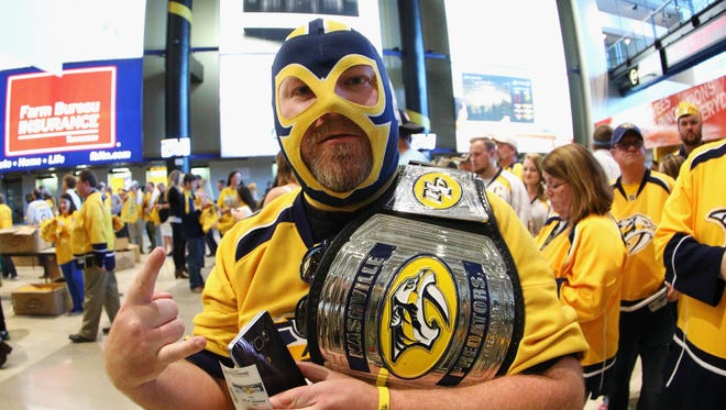A Nashville Predators fan poses prior to Game 3 of the Western Conference final.