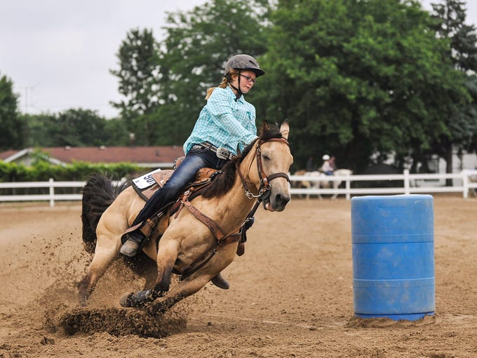 Hope Griest and gallops her horse, Holly, around a