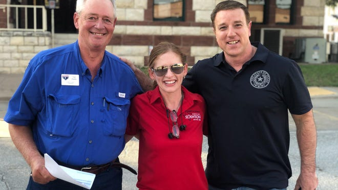 State Representative-elect Shelby Slawson is flanked by Erath County Republican Party Chairman Gil Parks (left) and State Sen. Pat Fallon (R-Prosper) outside the Erath County Courthouse in Stephenville as the early results were released Tuesday night from the Republican Runoff Election voting.