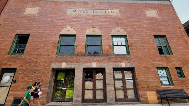 The 1915 Mayer Building, which held the Ioka marquee for 80 years in downtown Exeter, looks different without the iconic piece.