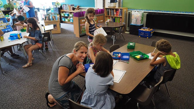 First-graders in Amy Spivack's classroom attend the first day of school a few years ago at New Franklin Elementary School in Portsmouth.