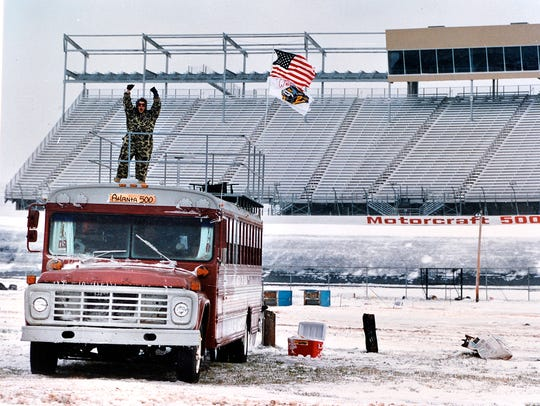 One fan braves the elements as snow covers the infield