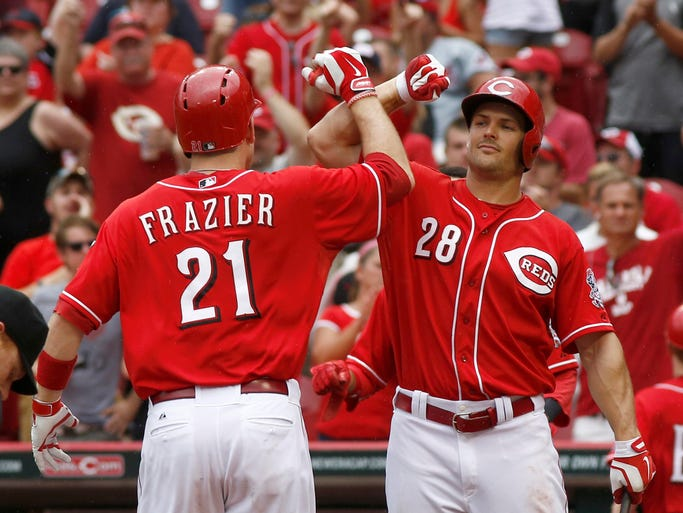 Cincinnati Reds' Todd Frazier (21) is congratulated by Chris Heisey (28) after Frazier hit a two-run home run off Pittsburgh Pirates pitcher Vance Worley in the sixth inning.