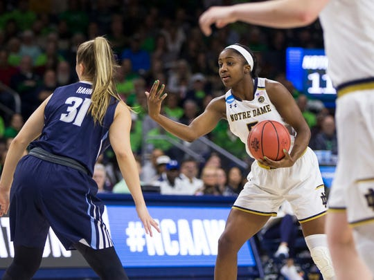 Notre Dame's Jackie Young, right, directs a teammate as Villanova's Adrianna Hahn (31) defends during a second-round game in the NCAA women's college basketball tournament Sunday, March 18, 2018, in South Bend, Ind. Notre Dame won 98-72.