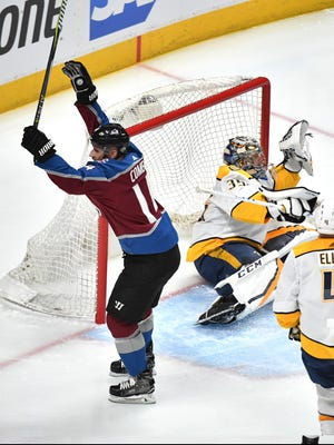 Colorado Avalanche left wing Blake Comeau (14) celebrates his goal early in the first period of game 3 of the first round NHL Stanley Cup Playoffs at the Pepsi Center, Monday, April 16, 2018, in Denver, Colo.
