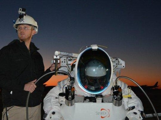 To skydive from the edge of space, Google executive Alan Eustace – shown before his balloon lifted off – needed a suit with key differences from those of astronauts, say officials at ILC Dover, which created his gear.