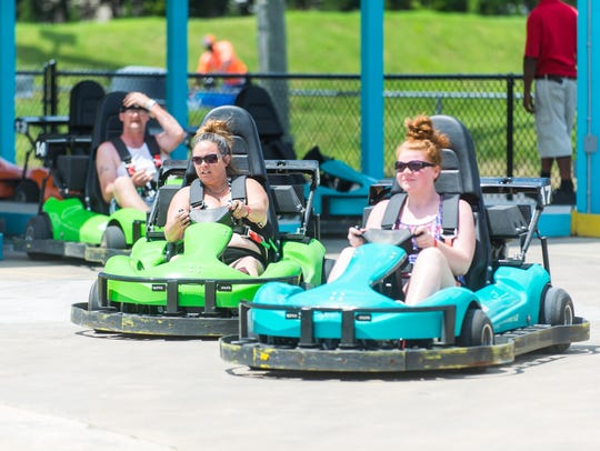 Racers take off on the Miami Drift track at Jolly Roger
