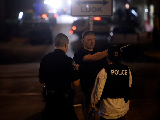 Emergency crews investigate a scene on Water Street