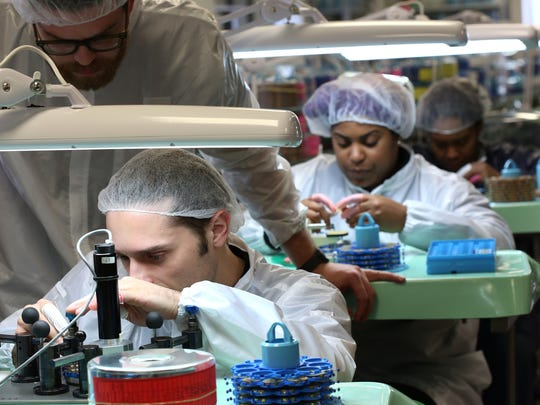 Shinola workers on the movement assembly line assemble