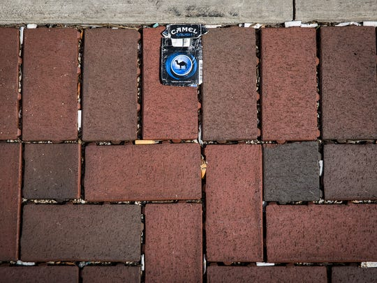 Gaps between brick pavement on Walnut Street collect