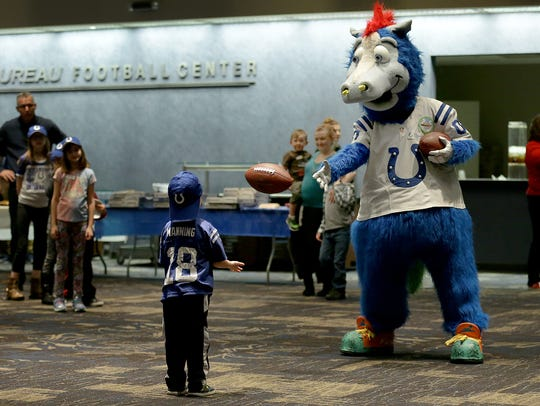 Colts mascot Blue plays catch with the children in