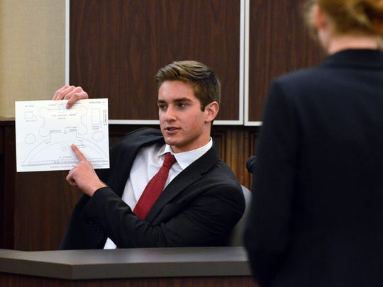 Ray High School student Brad Breckenridge (left), competing as a witness, uses a diagram of a murder scene while being questioned by attorney Julie Graves (right), a Ray High School on Saturday, Feb. 4, 2017, during the Region 2 high school mock trial competition at the Nueces County Courthouse.