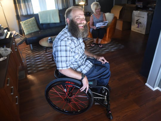 Chris Veseth is all smiles as he sits in his new wheelchair