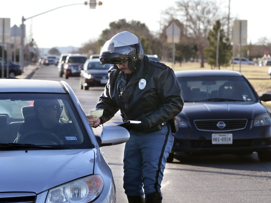 EPISD Police Department Lt. Zeke Garcia makes a traffic stop in the school zone outside Burges High School on Friday afternoon as school was letting out.