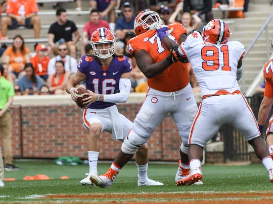 Clemson quarterback Trevor Lawrence (16) runs near \ offensive guard John Simpson (74) during the 1st quarter of the spring game in Memorial Stadium in Clemson on Saturday, April 14, 2018.