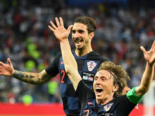 Luka Modric celebra luego de anotarle un gol a Argentina.