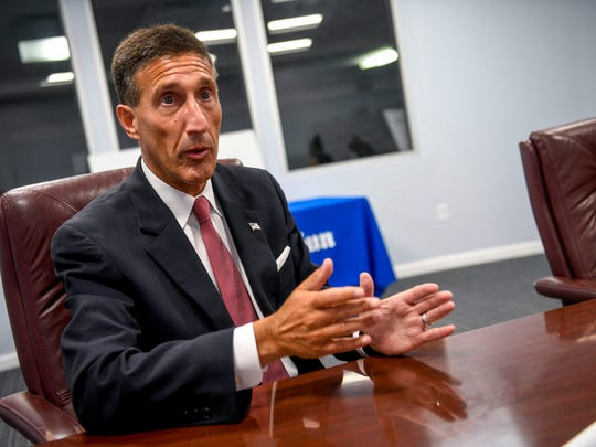 U.S. Representative David Kustoff (R - TN, 8th District) speaks with reporters at The Jackson Sun in Jackson, Tenn., on Thursday, Aug. 16, 2018.