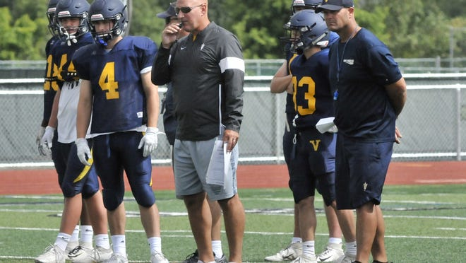 Victor football coach Geoff Mandile, center, said he wasn't surprised by the decision to delay the start of fall sports.